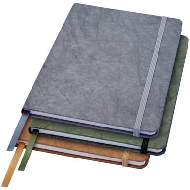 A pile of Stone Notebooks In Green, Grey and Brown