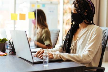 Lady wearing mask at desk